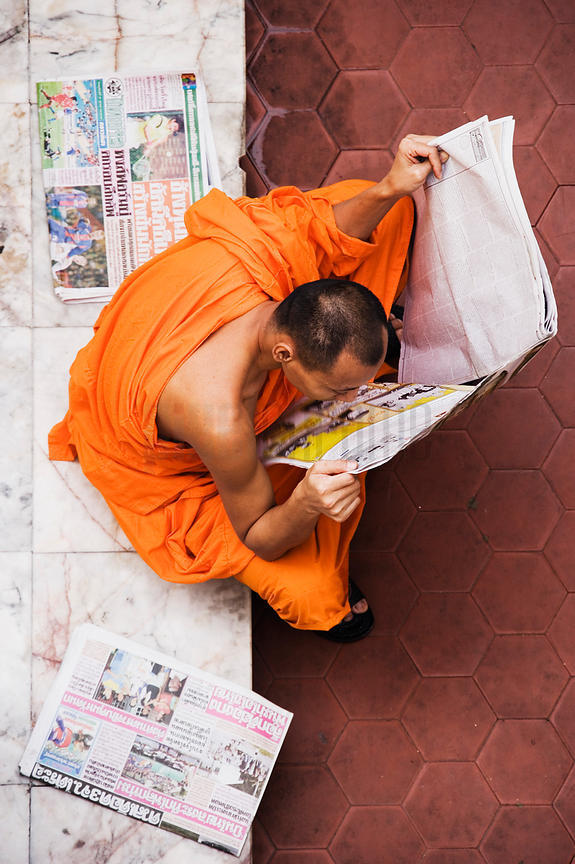 Buddhist Monk Reading Paper at Wat Indrawihan, Bangkok, Thailand