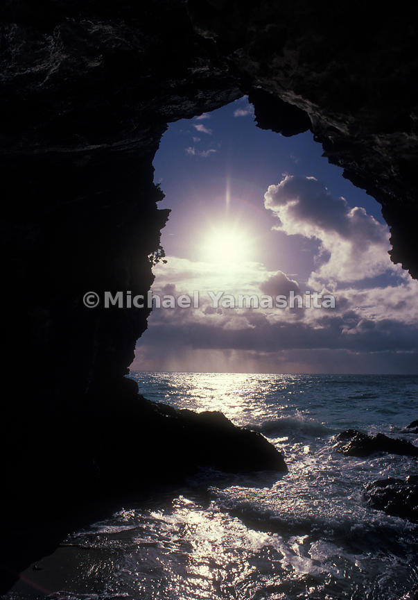 A view of the sunset from under a natural arch in Bermuda.