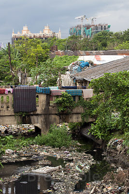 Garbage fills a putrid creek, Dhapa, Kolkata, India. Locals eat fish from the creek. Dhapa is a large industrial zone that processes most of Kolkata's garbage and recycling.