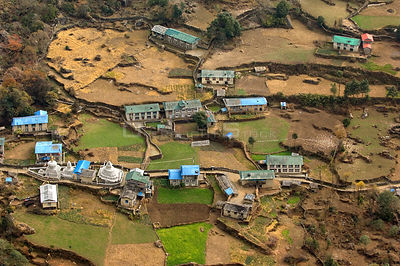 Aerial view of buildings  surrounded by agricultural fields, Himalayan foothills, Nepal, December 2007