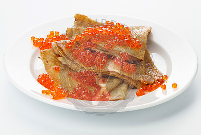 Pancake with red caviar on white background