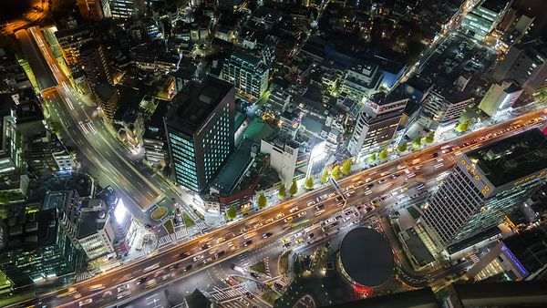 Bird's Eye: Above the Lights of Major Roads Crossing One Another In Tokyo At Night