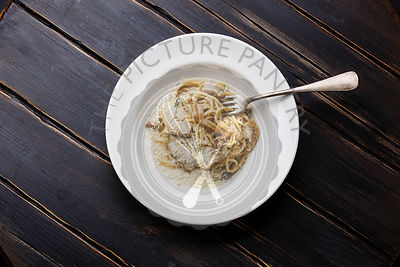 Pasta Spaghetti with Porcini mushrooms and Parmesan cheese on plate on wood table background