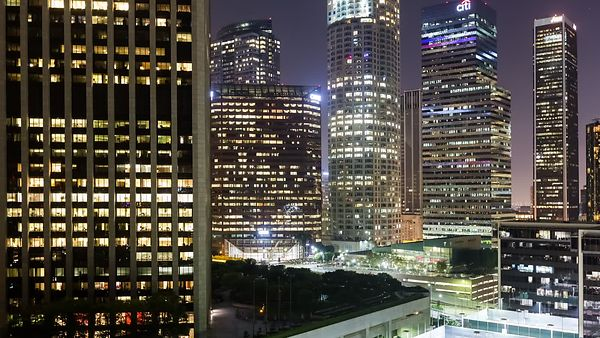 Close Up: An Evening In The Heart Of Downtown L.A. - Panning Traffic, Street Grids, High-Rises, & Searchlights