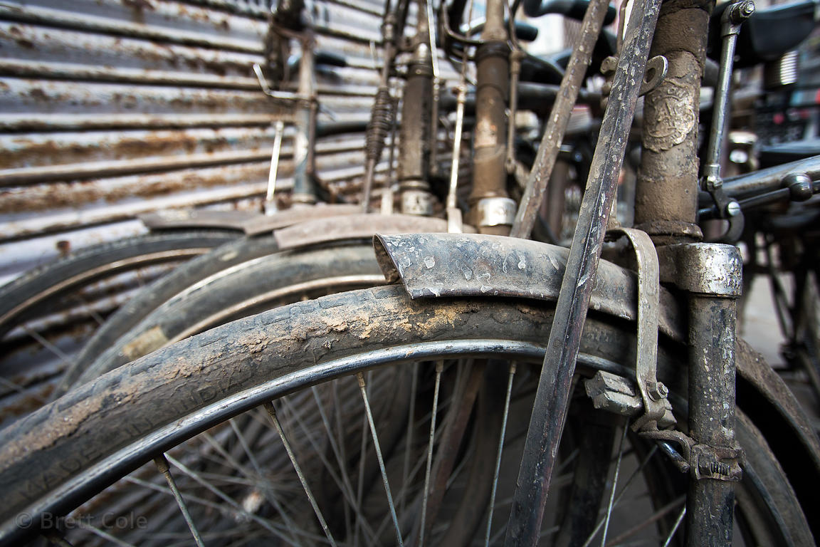 Weathered bicycles in Delhi, India