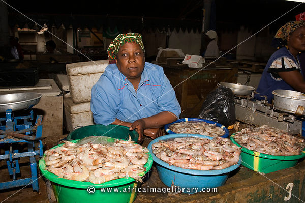 Woman selling prawns. Mercado Central is housed in a building dating to 1901, Maputo, Mozambique
