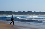 Fisherman fishing on the beach at Rocktail Bay, Maputaland, Kwazulu-Natal, South Africa