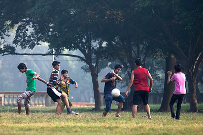A soccer game on the Maidan, a large park in central Kolkata, India.