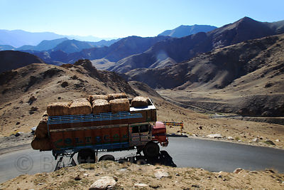 A truck carries hay over Khardung La pass, Leh, Ladakh, India