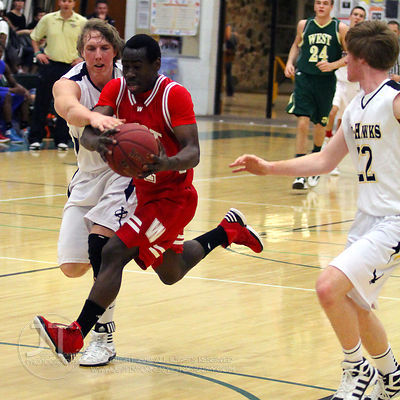 Davenport West's Joe Scott (21) is fouled driving to the basket by Cedar Rapids Xavier's Kevin Hosch (22) in the first half o...