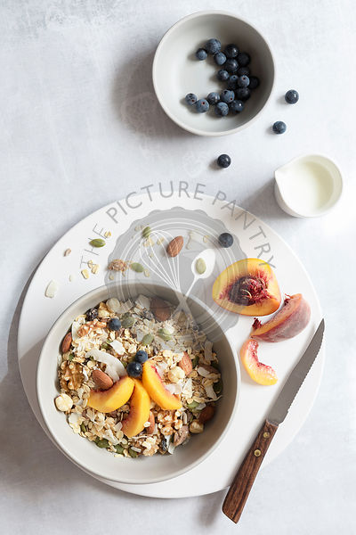 Ingredients prepared for a healthy breakfast of fresh fruit and muesli.
