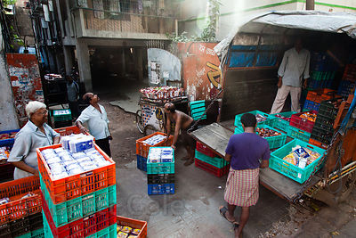 Workers unload trucks with supplies for the celebration of Durga Puja in Sovabazar, Kolkata, India.