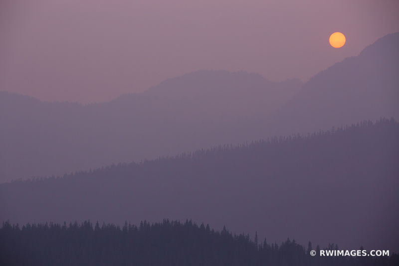 FOREST FIRE SMOKE SUNSET MOUNT RAINIER NATIONAL PARK WASHINGTON