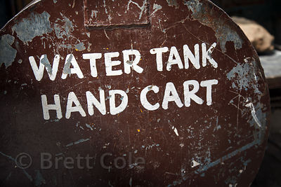 "A metal tank reading ""Water Tank Hand Cart""on Chowpatty Beach, Mumbai, India."