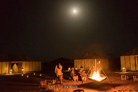A night scene at a Bivouac tent setup on the Erg Chebbi Sand dunes in Sahara Desert of Morocco.