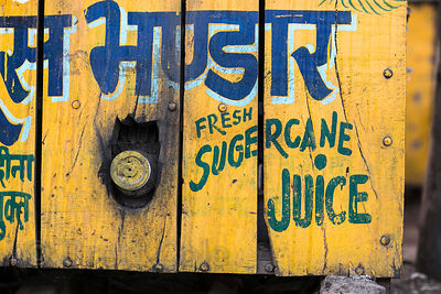 Weathered sign for fresh sugar cane juice at a market in Pushkar, Rajasthan, India