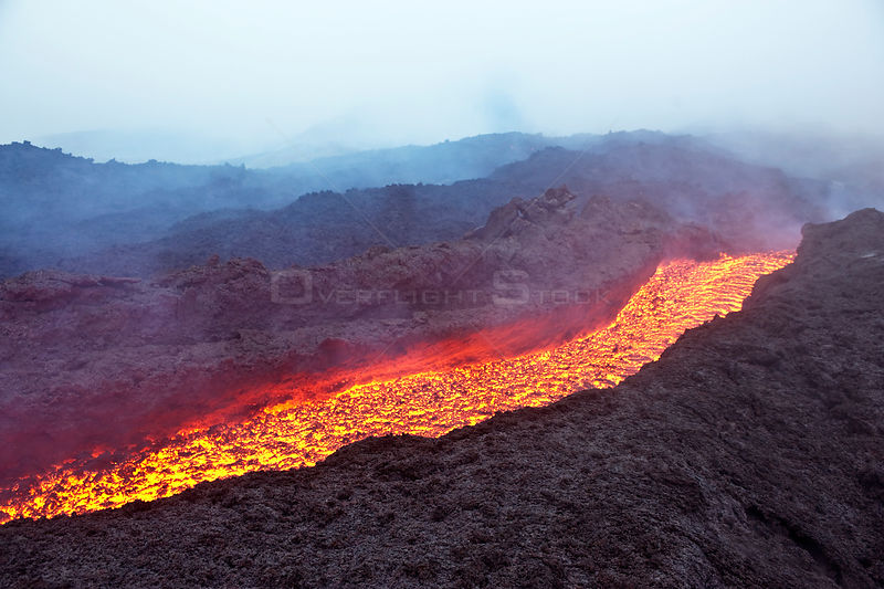 Aerial view of a river of lava flowing from the Pacaya volcano, Los Pocitos, Guatemala, Central America, June 2010