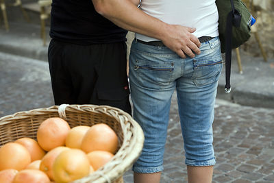 France - Paris - A man caresses his wife's back in the market on the Rue Mouffetard.