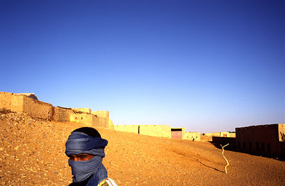 A boy wrapped against the wind, Mauritania