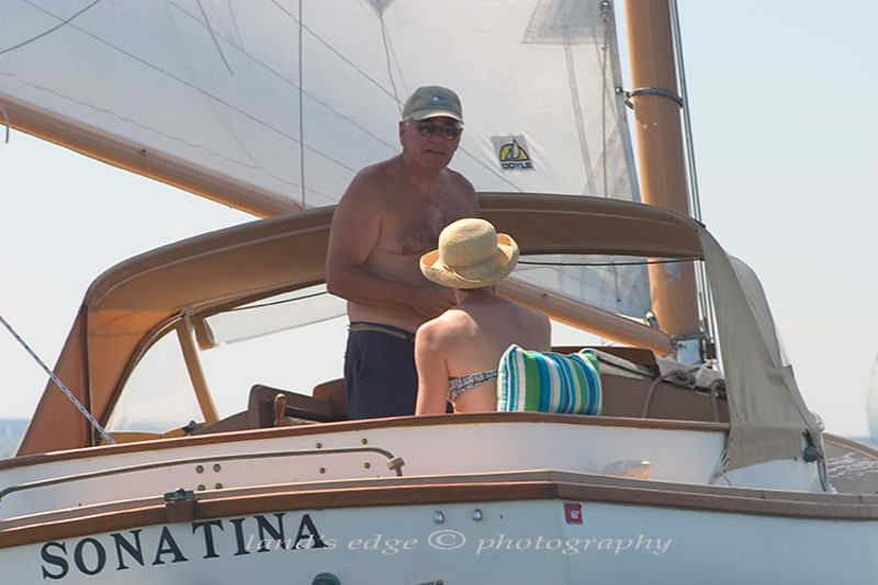 John ? and his wife head towards the final mark rounding at the Squeteague harbor catboat rendezvous in Buzzards Bay