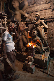 Sculptors in Kumartoli, Kolkata, India, create spectacular idols for the Durga Puja festival. They  use a straw form covered ...