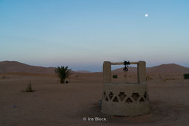 The moon sets over the desert sand dunes in Erg Chebbi in southeastern Morocco.