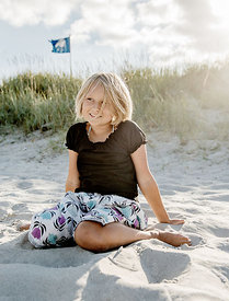 Younger Nordic girl sitting on the beach