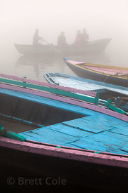 Boats on the Ganges River at sunrise, Varanasi, India.