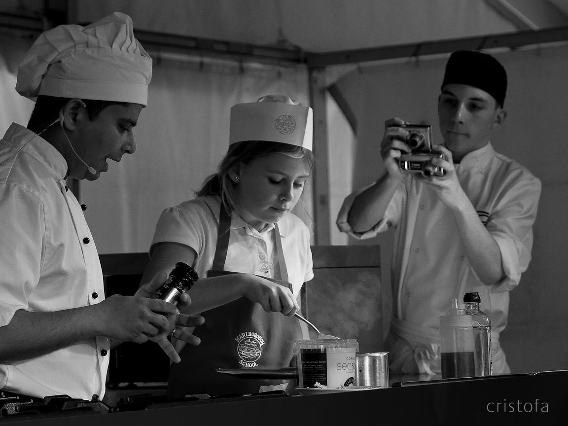 a girl has cooking lessons at the Falmouth Oyster Festival