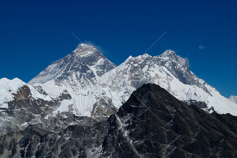 NEPAL Mount Everest -- The spectacular view of Mount Everest (centre left, the world's tallest peak at 8848m) from the top of...