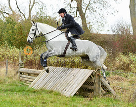 Richard Hunnisett jumping a hunt jump near Peake's. The Cottesmore Hunt at Somerby