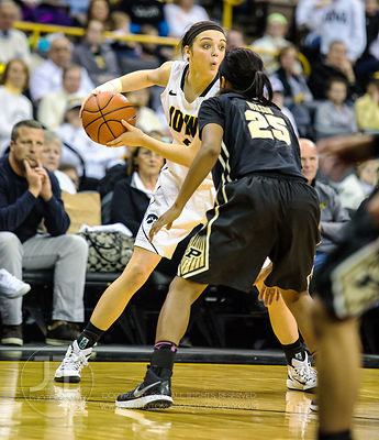 Iowa's Aly Disterhoft (2) jukes Purdue's April Wilson (25) during the second half of play at Carver-Hawkeye Arena in Iowa Cit...