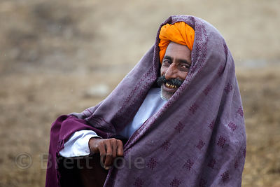 Man feeling the effects of smoking opium, Pushkar, Rajasthan, India
