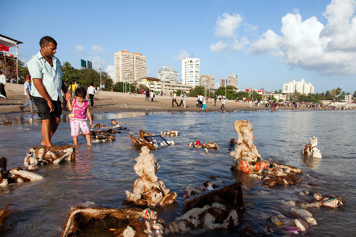 Washed up idols of Ganesh from the Ganesh Chaturthi festival, at Chowpatty Beach, Mumbai, India.
