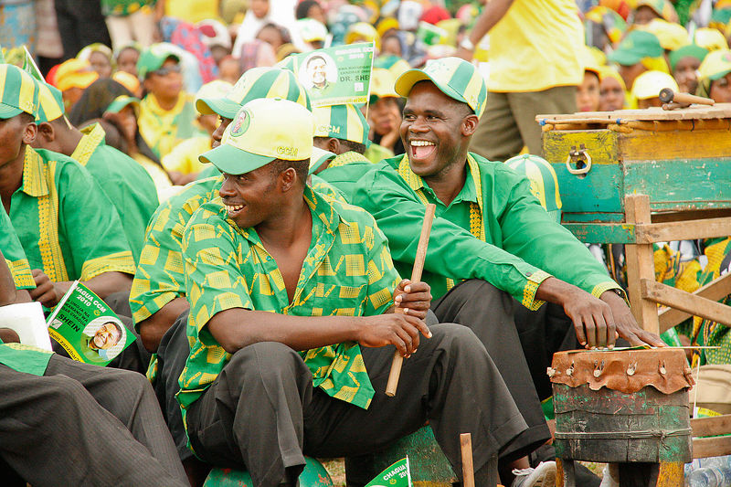 CCM supporters play drums.