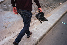 Sylvain is walking barefoot with his shoes in Paris, on June 8, 2014.