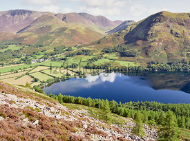 Views of Lake Buttermere on route to the summit of Red Pike with Robinson, Whiteless Pike and Grasmoor in the distance. The English Lake District, UK.