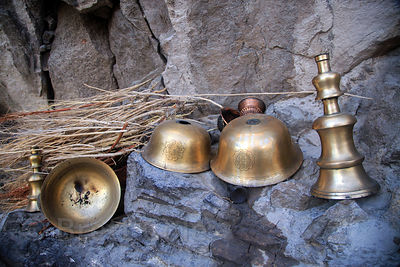 Brass bells and bowls at a monastery in Choglamsar, Ladakh, India