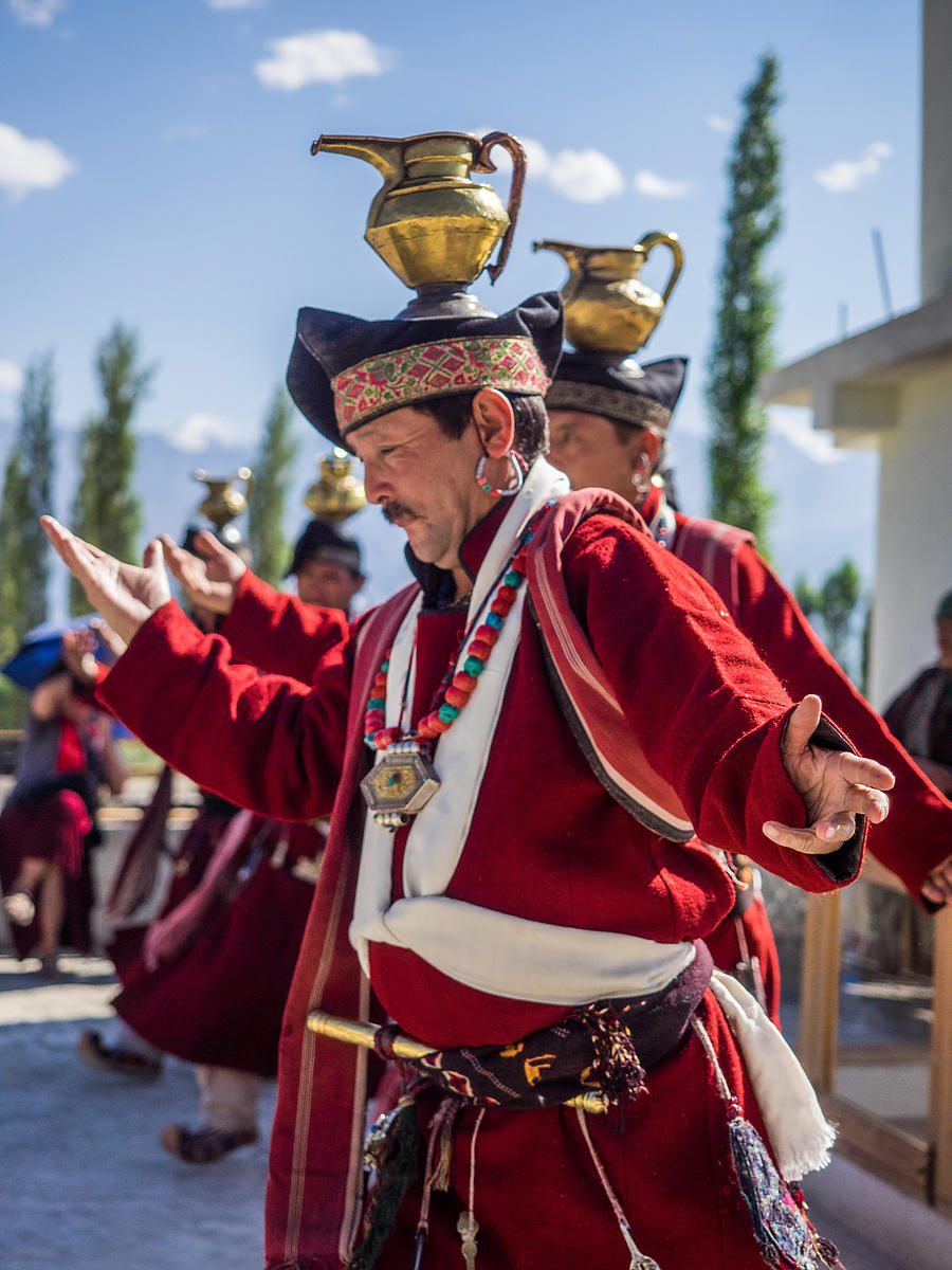 Ladakhi folk dancers perform for an audience.