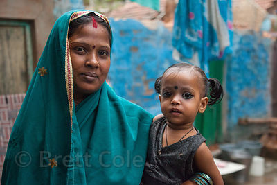 Portrait of a woman and her daughter in the Fakir Bagan area of Howrah, India