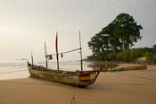 Fishing pirogue lying on the beach, Busua, Ghana