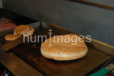 Giant hamburger bun thawing on grill at Arnold Burger