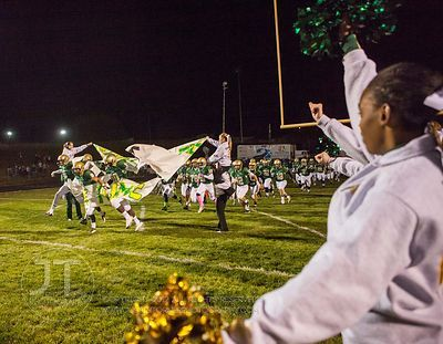 Iowa City West takes the field prior to the Battle for the Boot at Iowa City West Friday night, October 5, 2012. (Justin Torn...