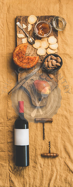 Wine bottle, vintage corkscrews and appetizers board, vertical composition