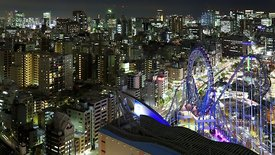 Bird's Eye: Ferris Wheel, Expressway, & Mid-Rises In Neon Light