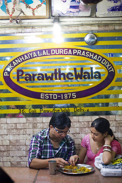 India - Delhi - Customers eating paratha inside Parawthe Wala restauran