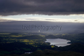 Looking across to lake Ullswater in the English Lake District at sunrise. UK.