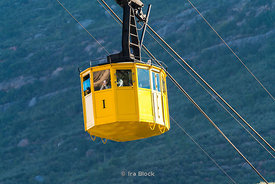 A cable car goes up to the Montserrat monastery along the Montserrat rocky range in Barcelona, Spain