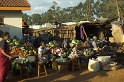 African street traders on market stall selling fruit and vegetables , Mumias , kenya Africa