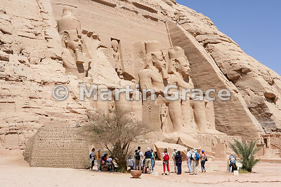 Tourist group in front of the Sun Temple of Ramesses II at Abu Simbel, Egypt